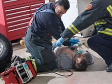Applying Defibrillator to Sudden Cardiac Arrest Victim